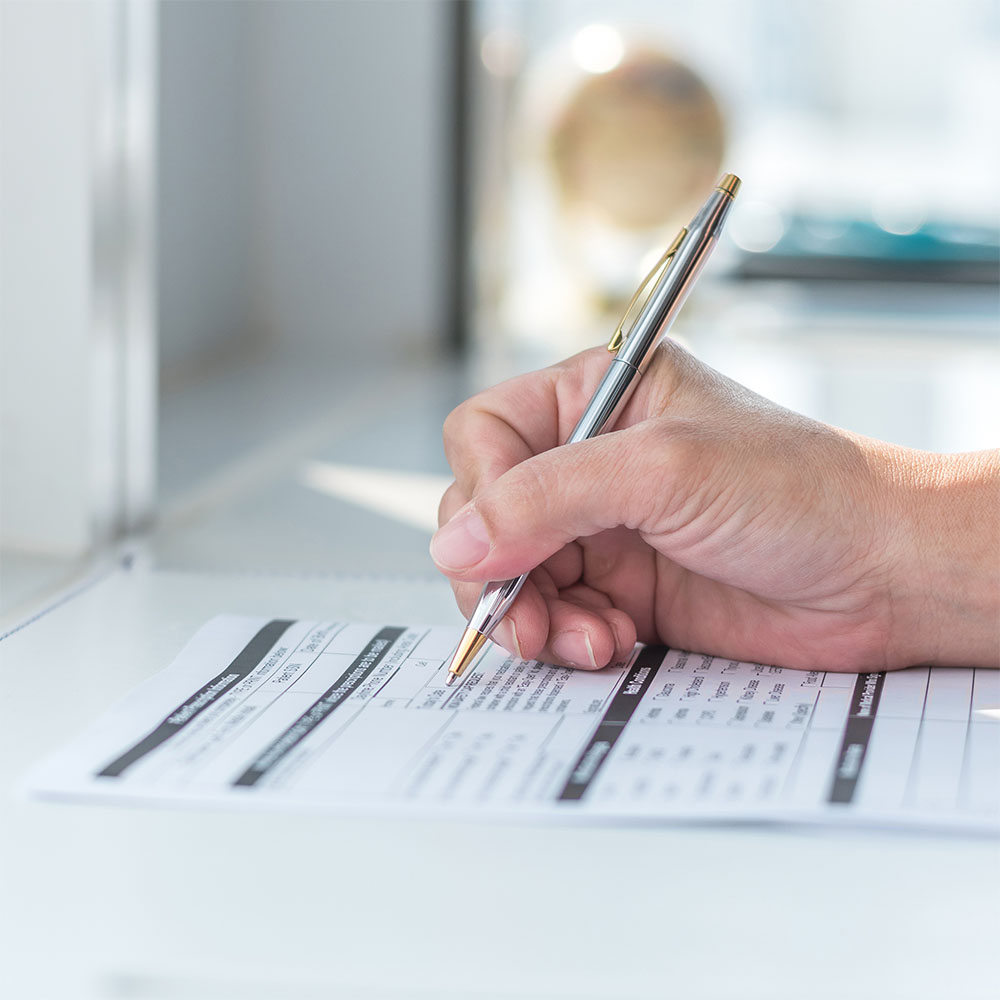 patient filling out medical forms or paperwork